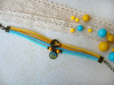 Браслет шнур замшевий жовто-блакитний з тризубом